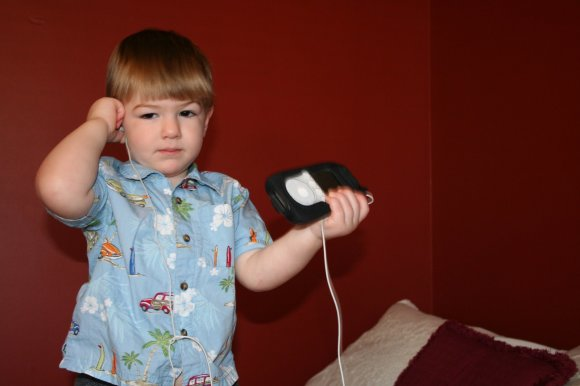 toddler listening to ipod