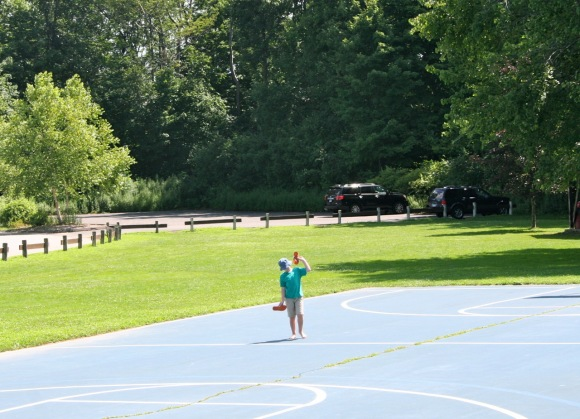summer boy basketball court