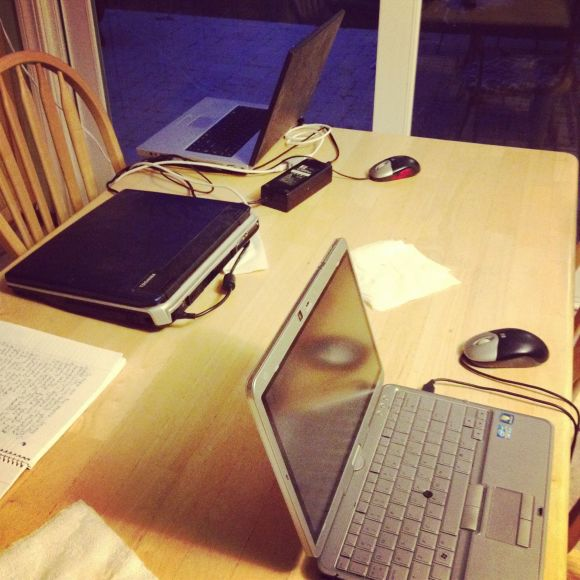 computers on the kitchen table