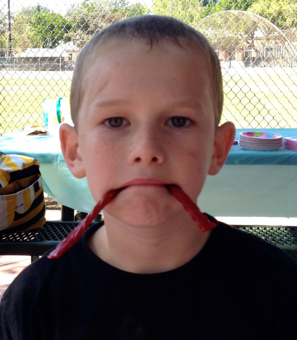 boy with licorice in mouth