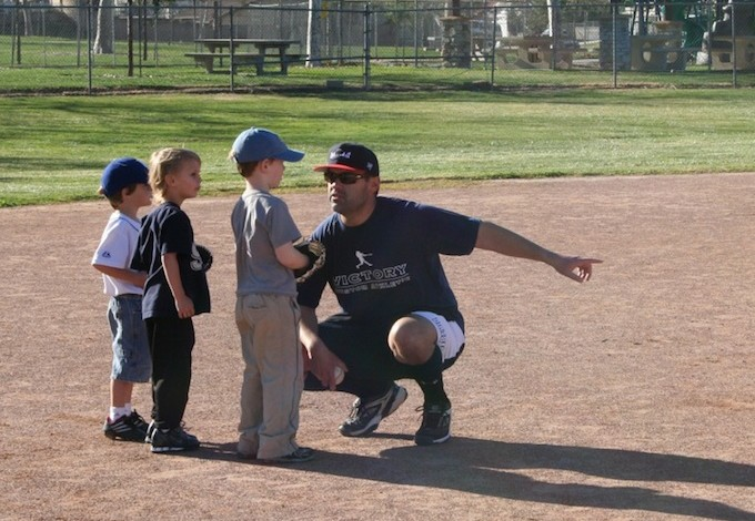 baseball coach with little boys