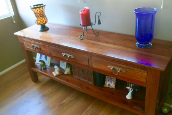 dusting with socks console table