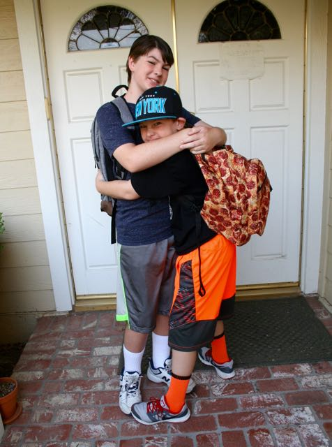 first day of school brothers hug