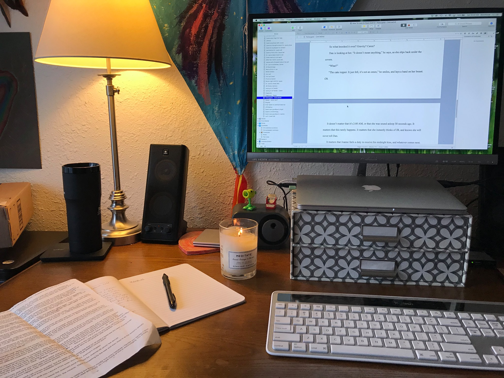 desk with computer and lit candle